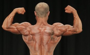 No Pose contracts the Delts better. Do this in between every set to trap blood inside